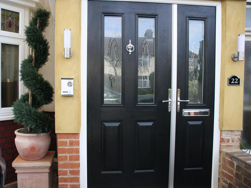 Navy blue composite door with side light