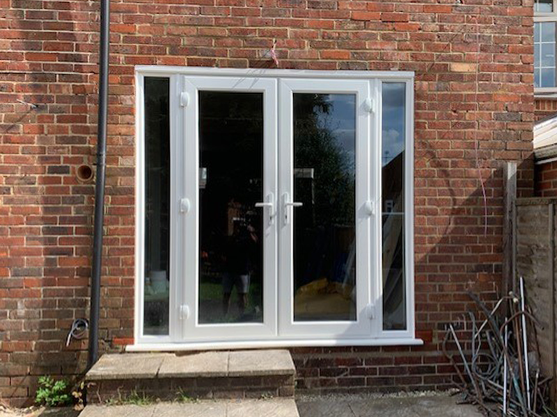 White uPVC French Doors with side lights