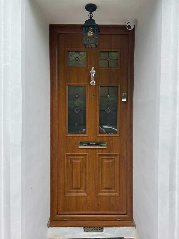 Faux wooden composite door