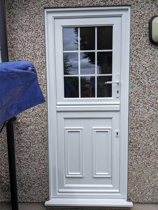 White UPVC door with stable door